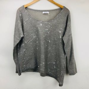 Silver paint splattered Barney's NY sweater